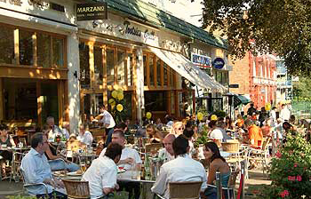 A3Y7C9 England London Belsize Park cafes on a summer afternoon